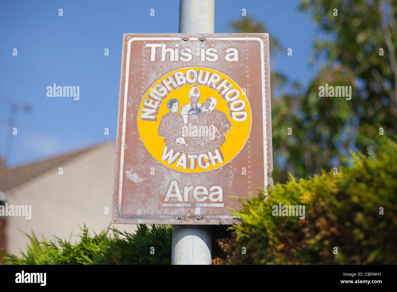 A neighbourhood watch signpost in an English country town. - Stock Image