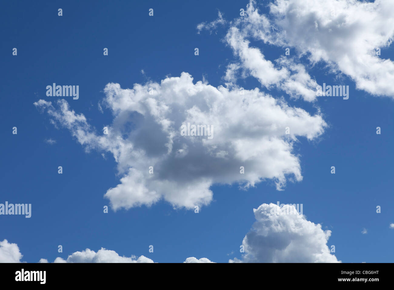 Fluffy white clouds set against a vivid blue sky in New South Wales, Australia - Stock Image