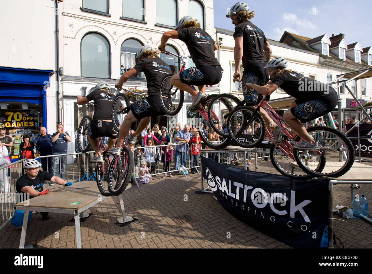 Isle of Wight cycling festival Stunt Rider mountain bike multiple exposure Newport Isle of Wight England UK - Stock Image