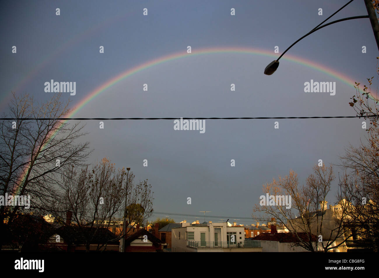 A double rainbow over a city - Stock Image