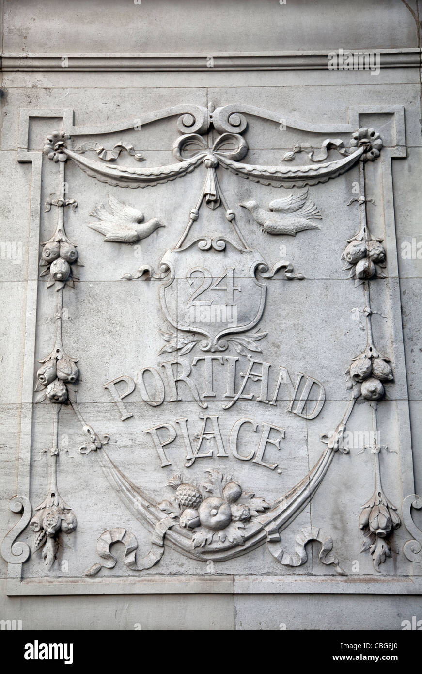 24 Portland Place - Name and Relief Carving on stone wall - Stock Image