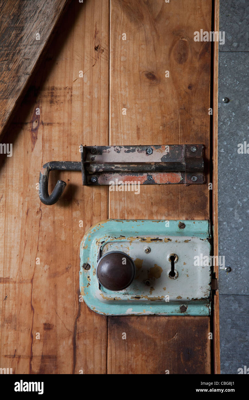 Two old-fashioned locks on a wooden door - Stock Image