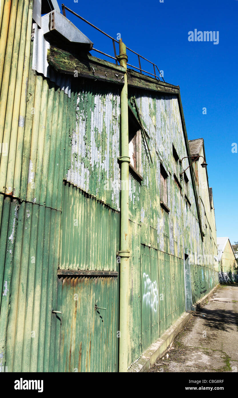 Derelict  looking warehouse, made of corrugated steel sheets. Stock Photo