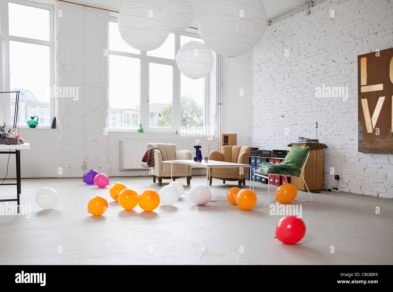 Multi colored balloons on the floor of a modern living room Stock ...