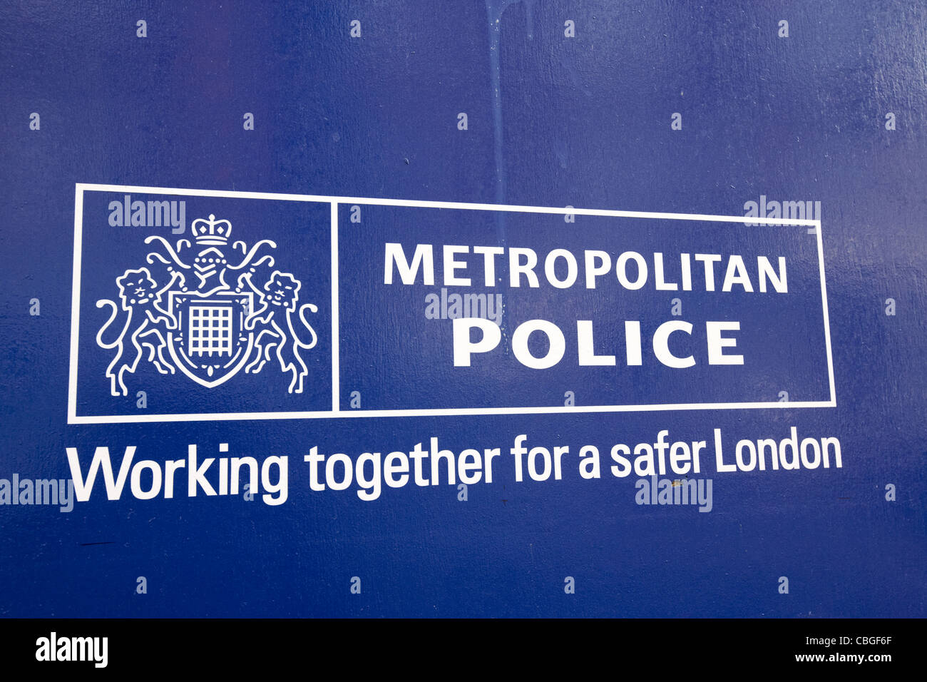metropolitan police logo and working together for a safer london slogan london england uk united kingdom - Stock Image