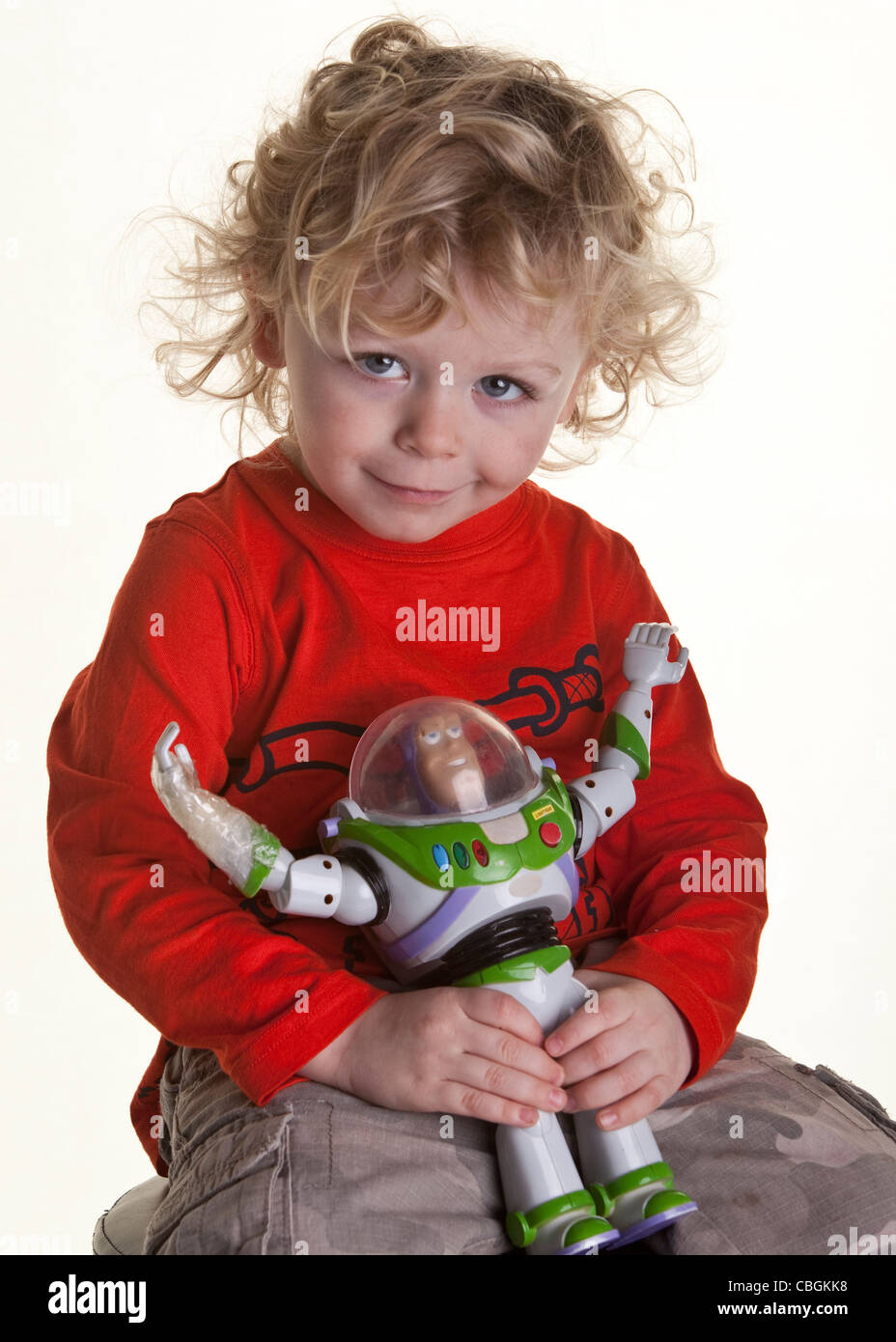 young boy with buzz lightyear toy - Stock Image