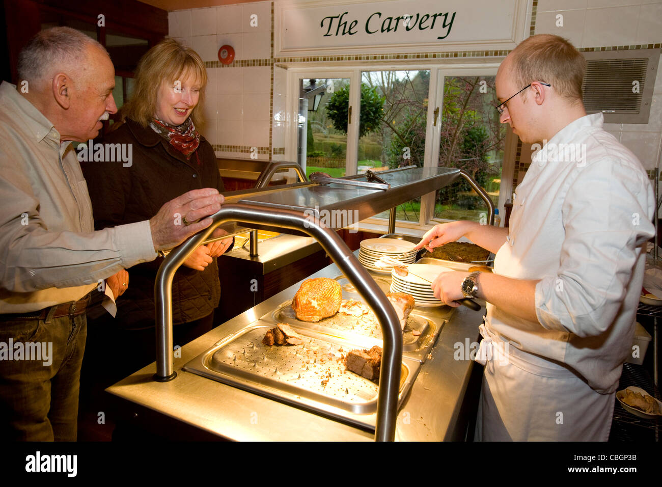 Customers, The Carvery, The Griffin Inn, Godshill, Isle of Wight, England, UK, - Stock Image