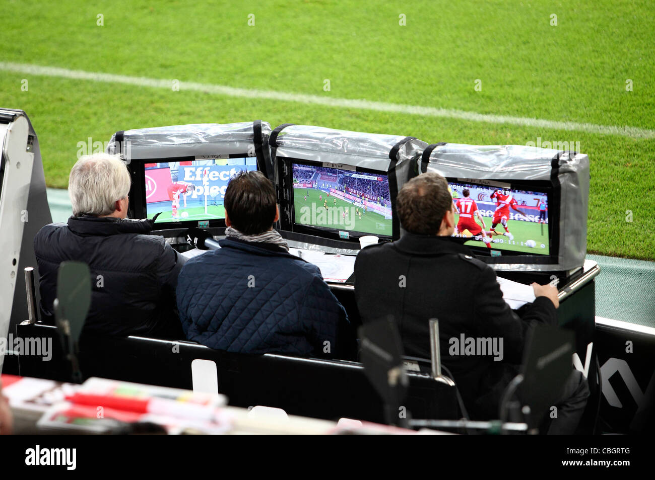 TV crew, production team during a football game in a sports station. Managing the TV images. - Stock Image