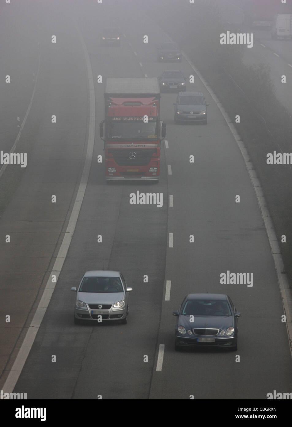 Motorway, Autobahn A52, traffic in thick fog. Essen, Germany, Europe. Stock Photo