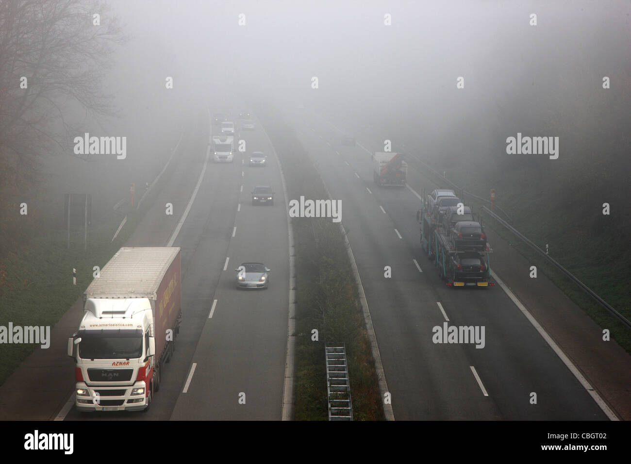 Motorway, Autobahn A52, traffic in thick fog. Essen, Germany, Europe. - Stock Image