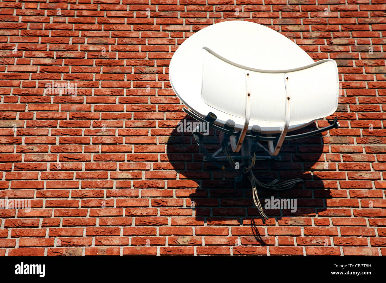 Satellite antenna, dishes, at the wall of a private house, for receiving TV channels, stations. - Stock Image