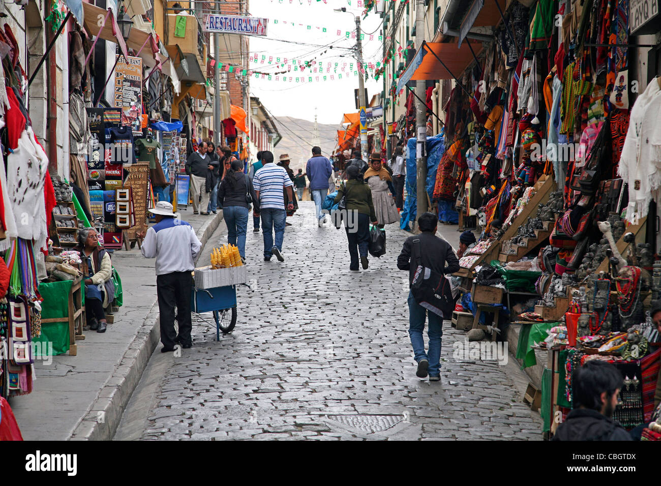 Pedestrians in street with souvenir shops for tourists in the city La Paz, Bolivia - Stock Image