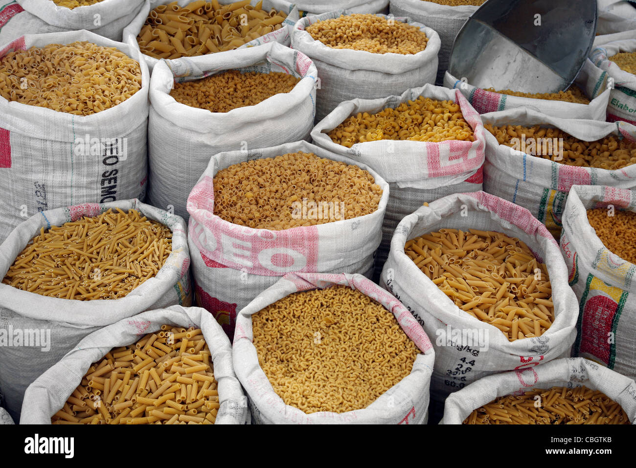 Pasta for sale in large bags on market in Challapata, Altiplano, Bolivia - Stock Image