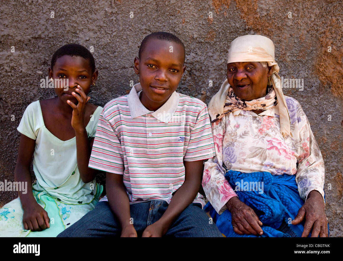 The family face - close resemblance in children and their great grandmother in a family near Voi in southern Kenya - Stock Image