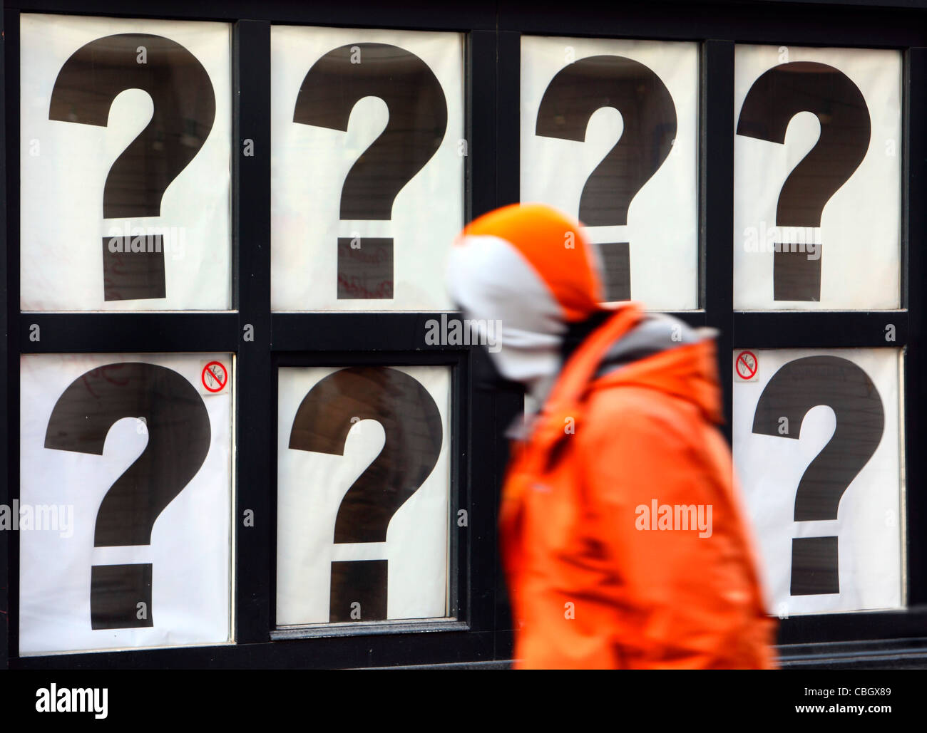 Closed shop. Shop window covered with question mark symbols. Antwerp, Belgium, Europe. - Stock Image