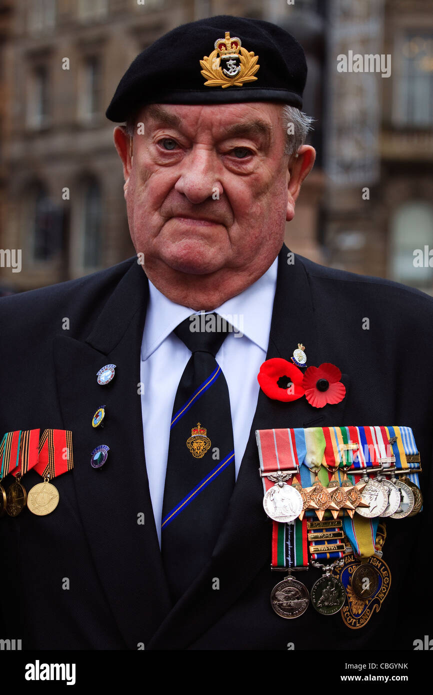 War veteran wearing his war medals at the remembrance Day Parade, George Square, Glasgow, Scotland, UK - Stock Image