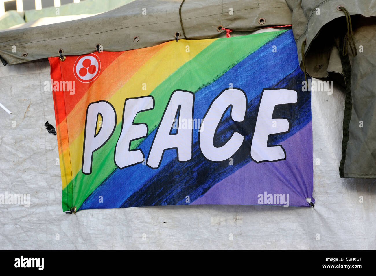 colourful peace banner at city protest camp nottingham england uk - Stock Image