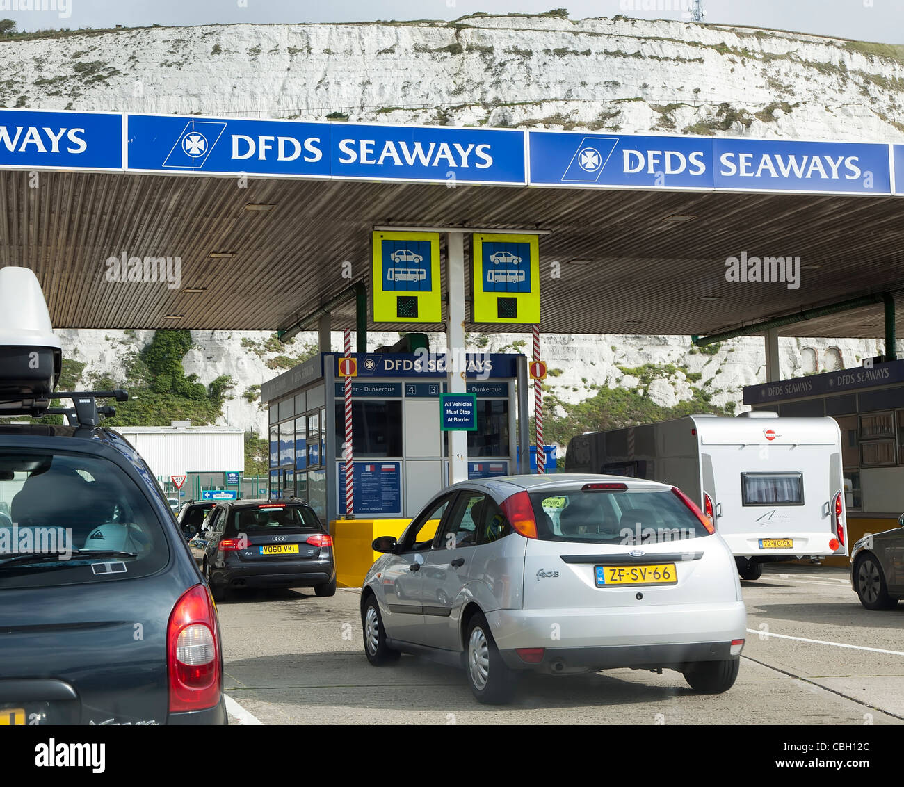 Cars queuing at check in line for DFDS Seaways ferries at Dover England UK - Stock Image
