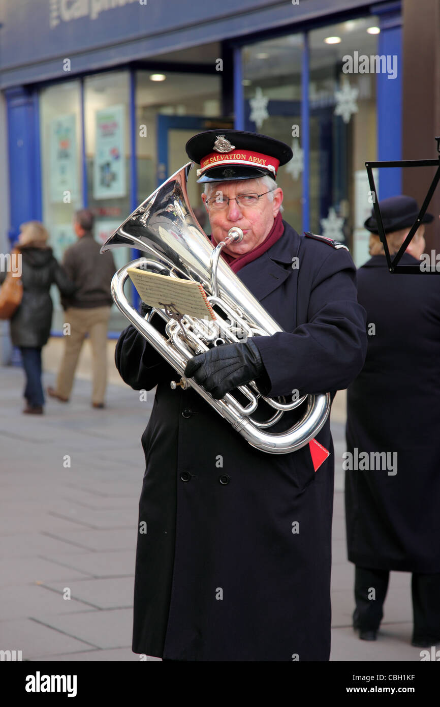Salvation Army member playing the Tuba - Stock Image