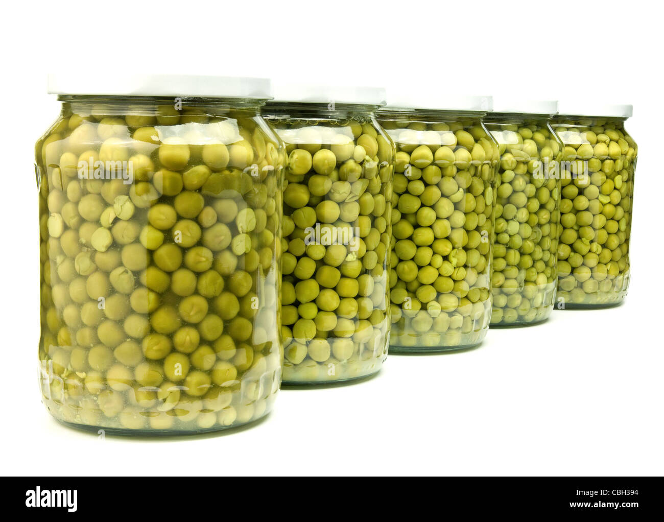 five jars of preserved green peas isolated on white - Stock Image