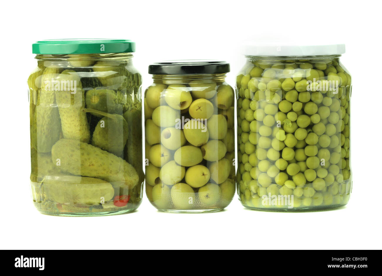 jars of preserved food isolated on white - Stock Image