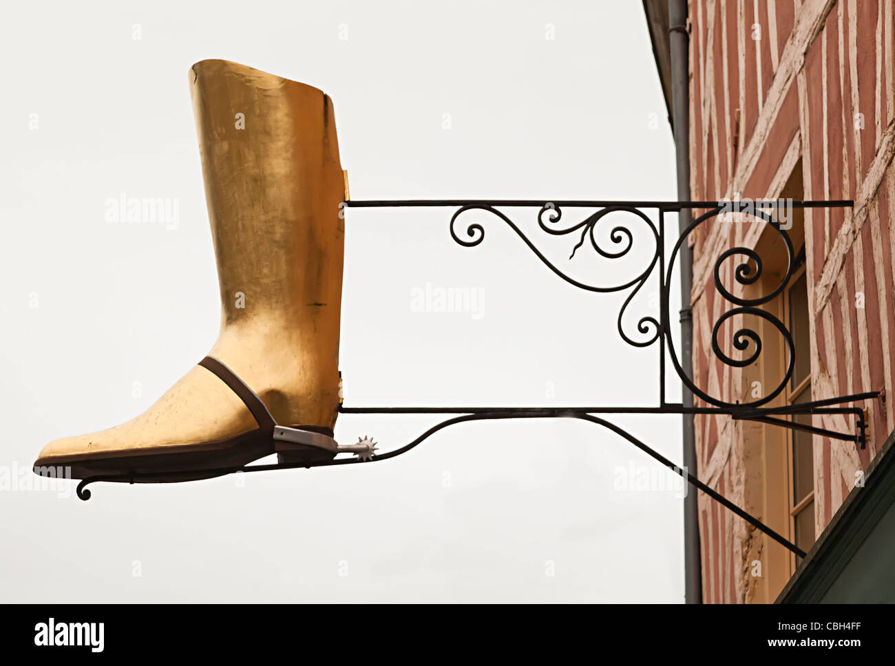 Boot with spur as sign for shop Auxerre France - Stock Image