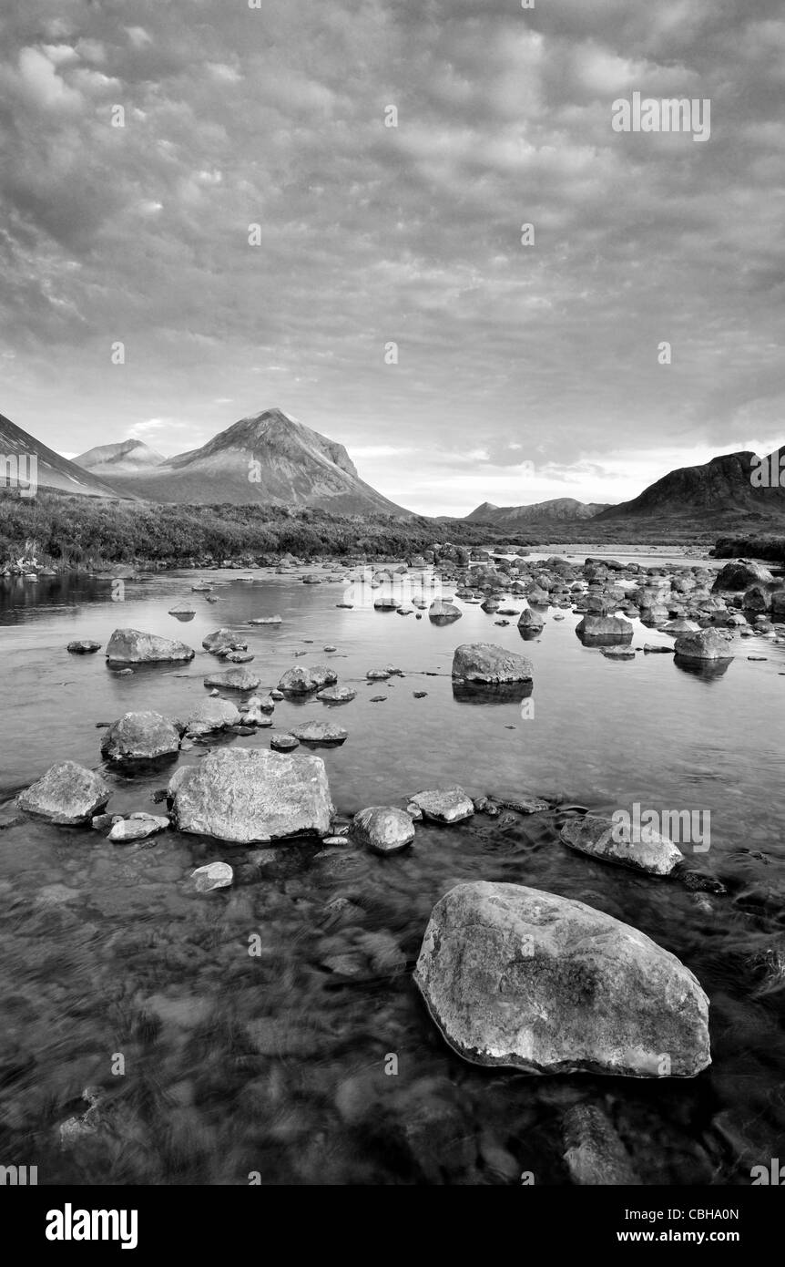 Black and white image of dramatic cloudy skies over Marsco and the River Sligachan on the Isle of Skye, Inner Hebrides, - Stock Image