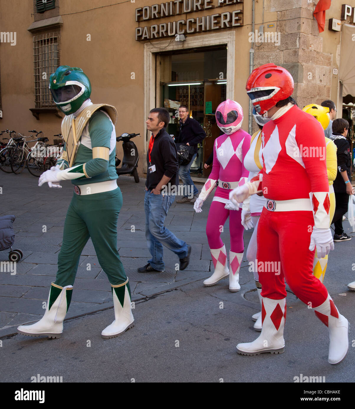People dressed as Mighty Morphin' Power Rangers during Lucca comics and games festival, 2011 Tuscany, Italy Stock Photo