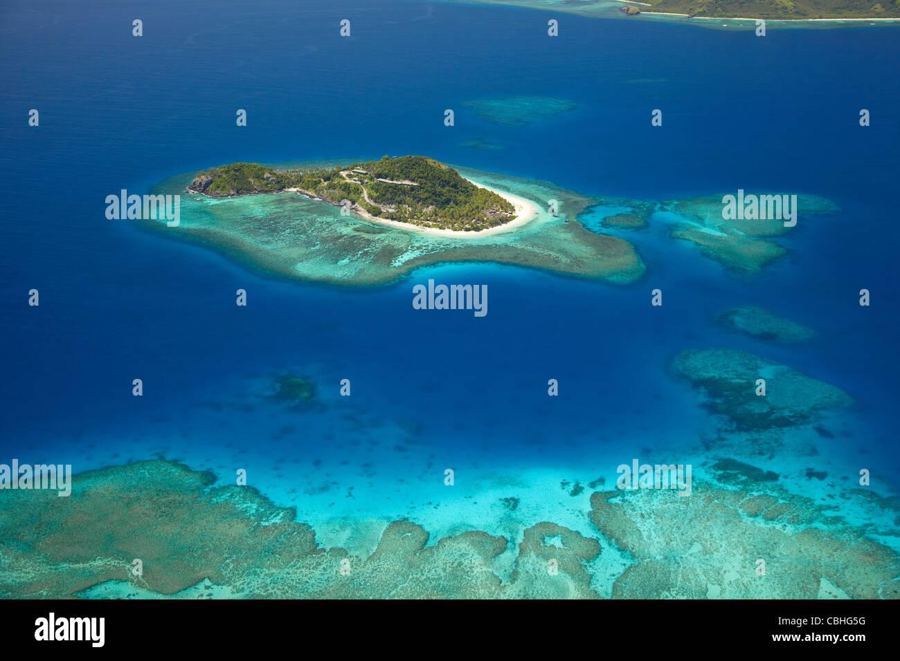 Matamanoa Island and coral reef, Mamanuca Islands, Fiji, South Pacific - aerial - Stock Image