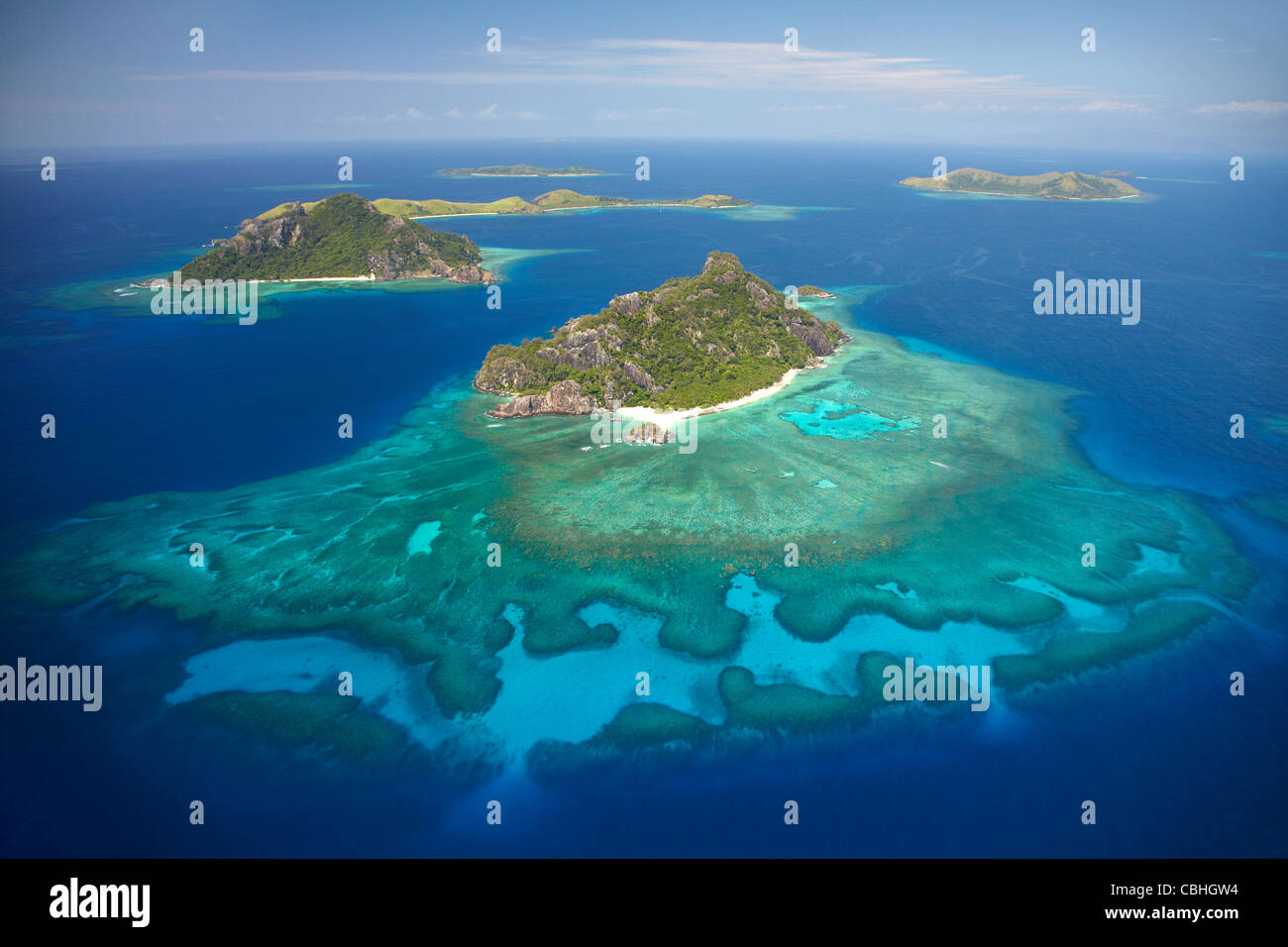 Monuriki Island and coral reef, Mamanuca Islands, Fiji, South Pacific - aerial - Stock Image