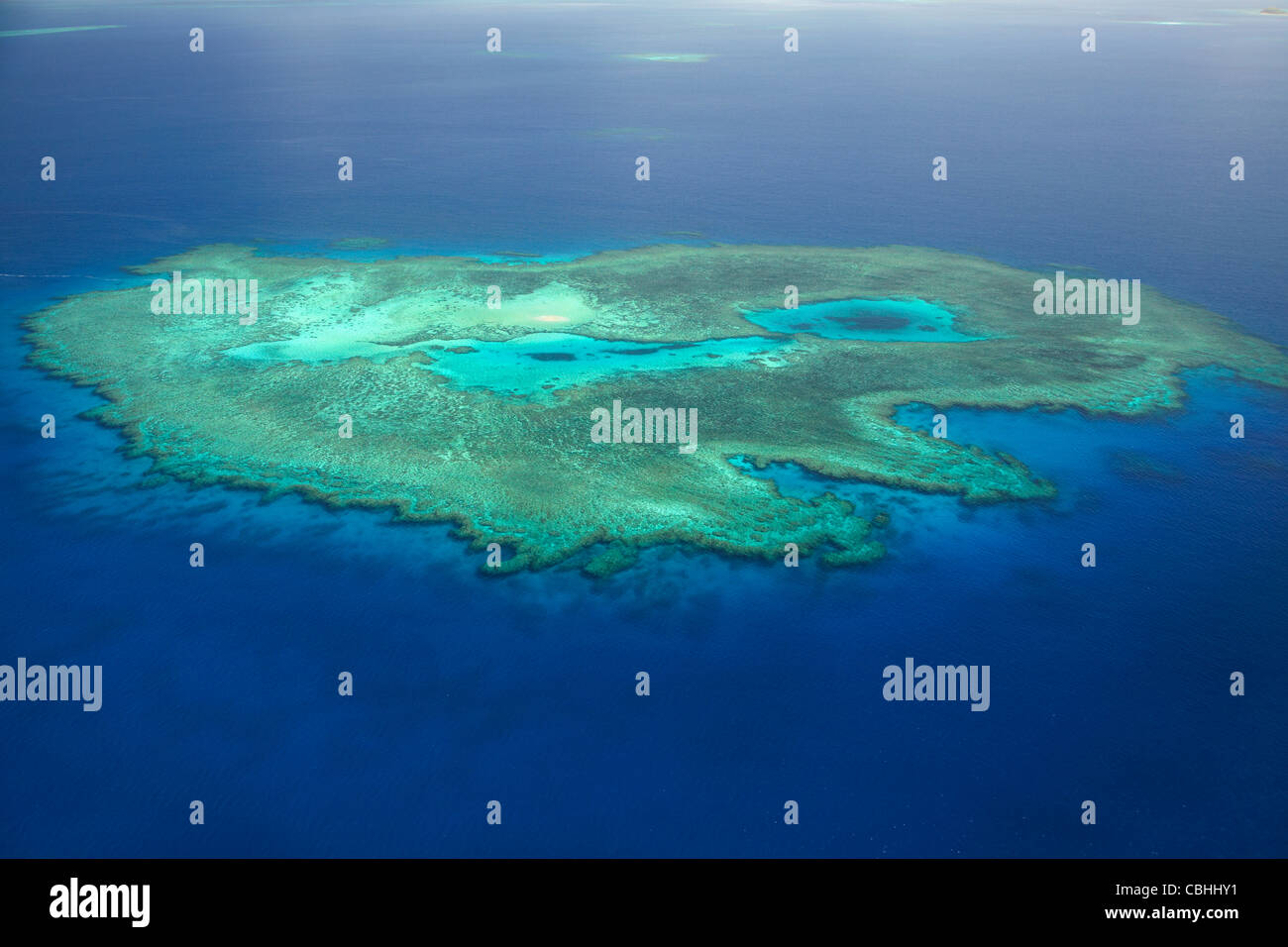 Coral reef near Treasure Island, Mamanuca Islands, Fiji, South Pacific - aerial - Stock Image