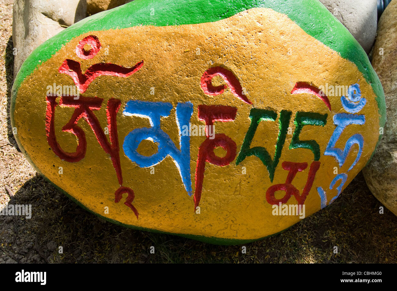 A colorful Mani stone in Tibet. - Stock Image