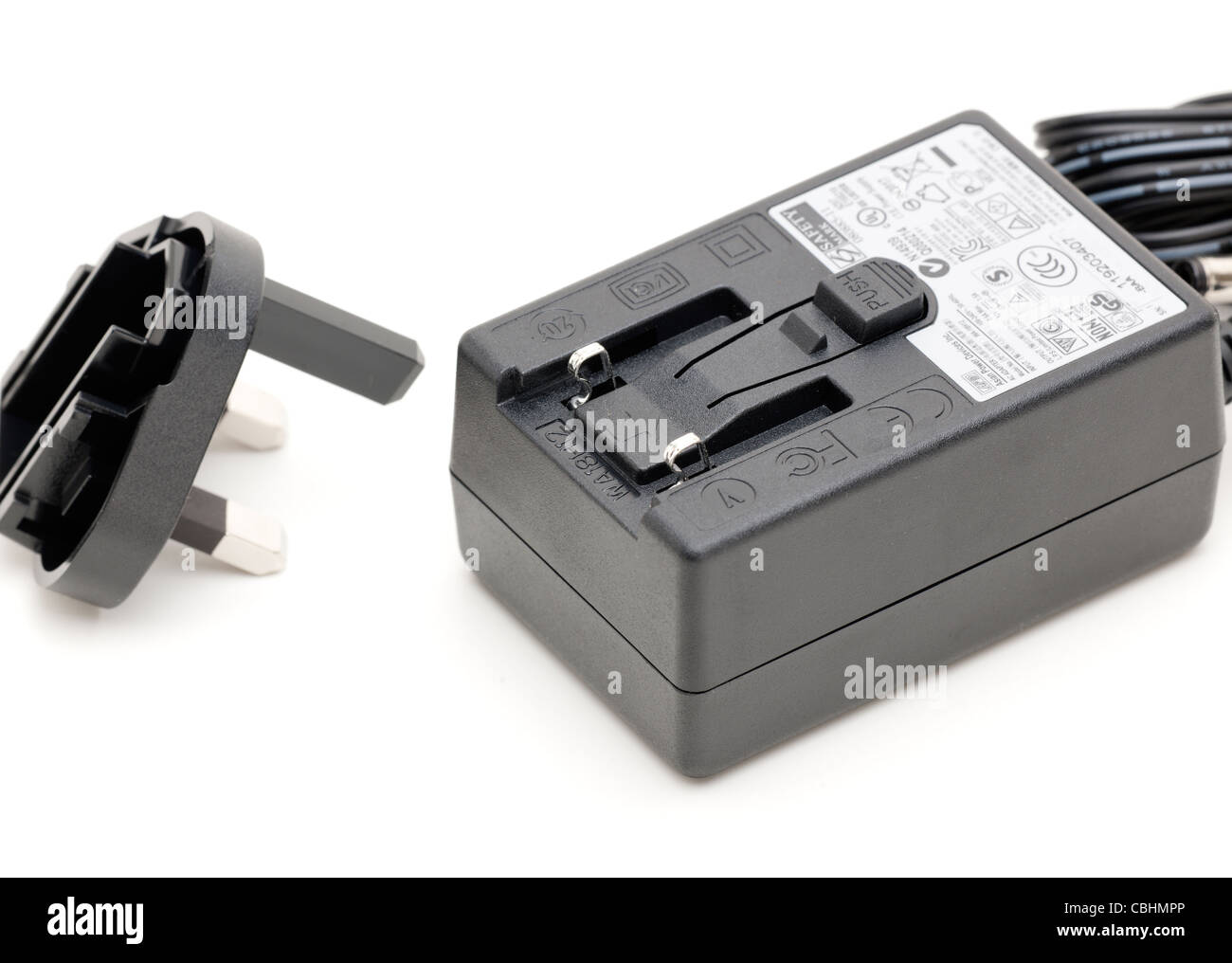 Power supply with removable UK three pin adapter - Stock Image