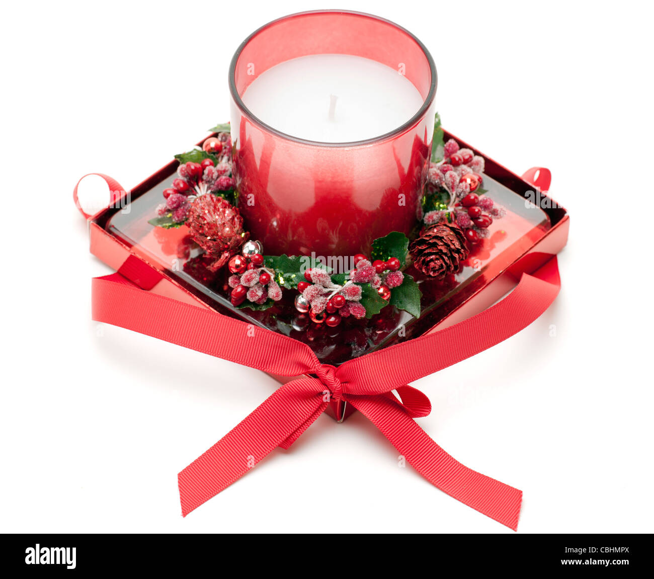 Decorative Christmas wreath candle with a red bow - Stock Image