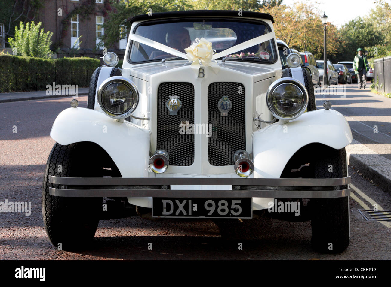 White wedding vehicle parked in inner Circle Regents Park awaiting the happy couple. Believe it or not, this is - Stock Image