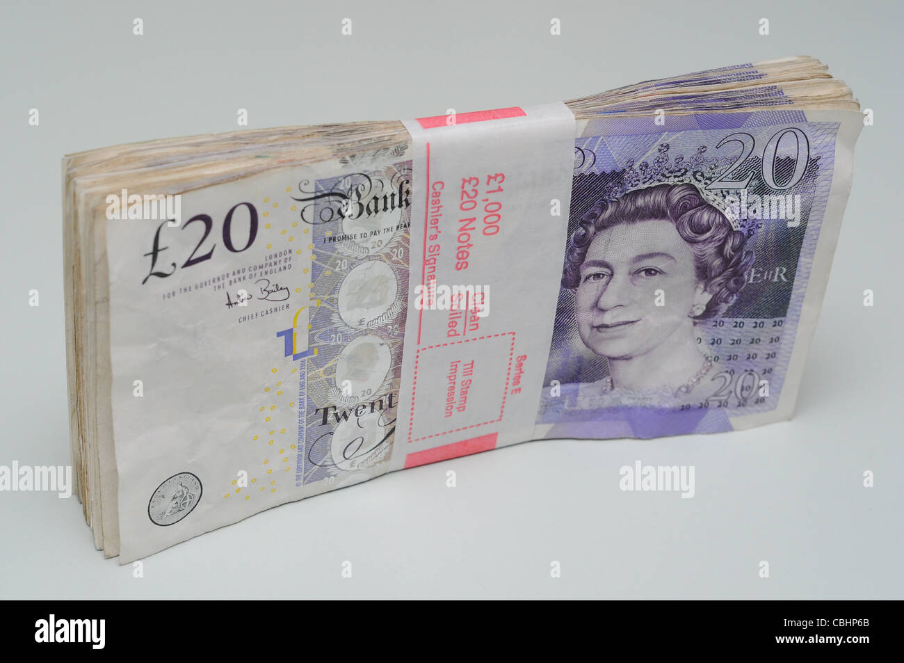 Bank wrapped bundle of one thousand pounds in twenty pound notes. Stock Photo