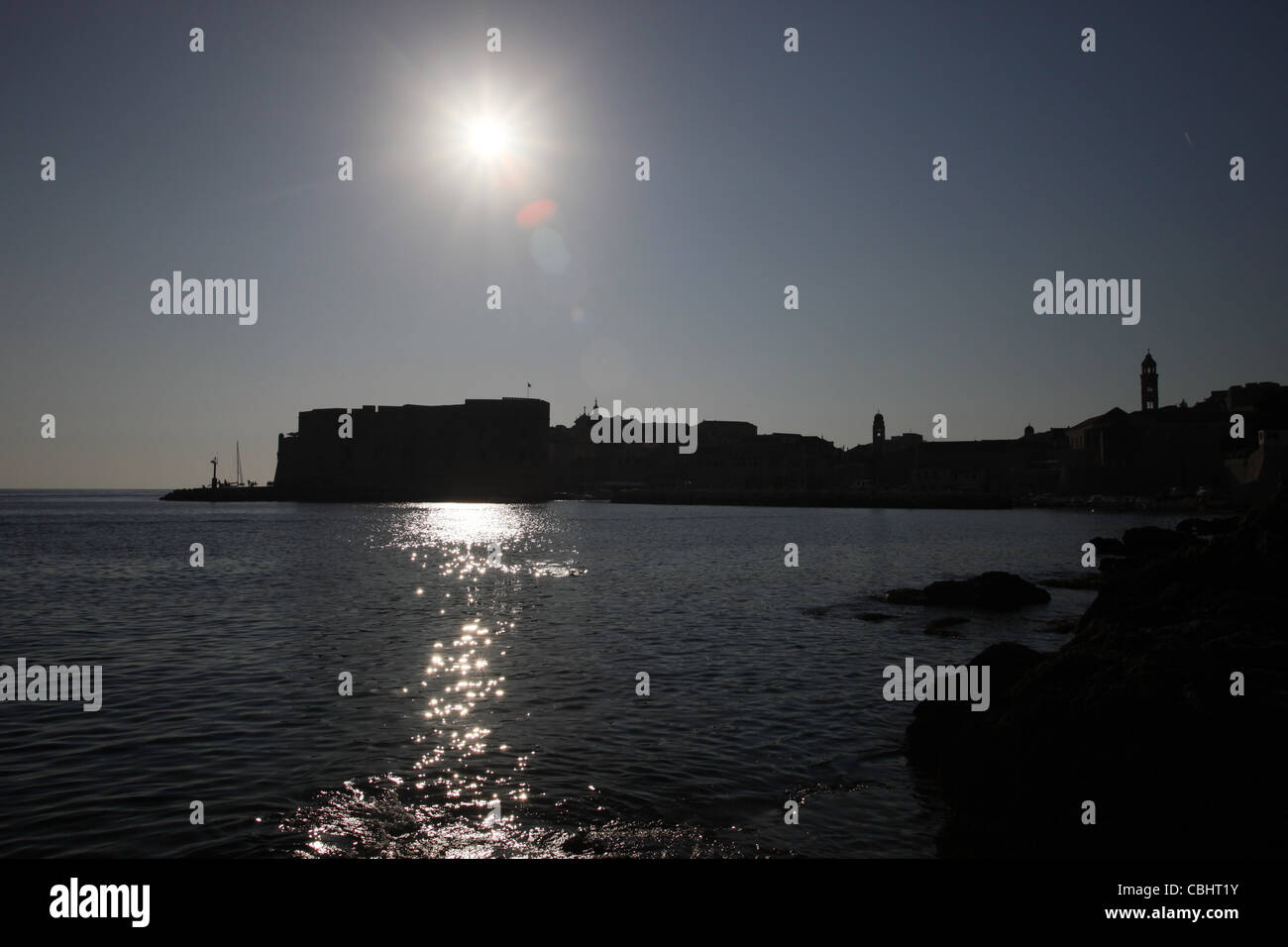 SUN SHINES OVER OLD PORT & HARBOUR OLD TOWN DUBROVNIK CROATIA 05 October 2011 - Stock Image