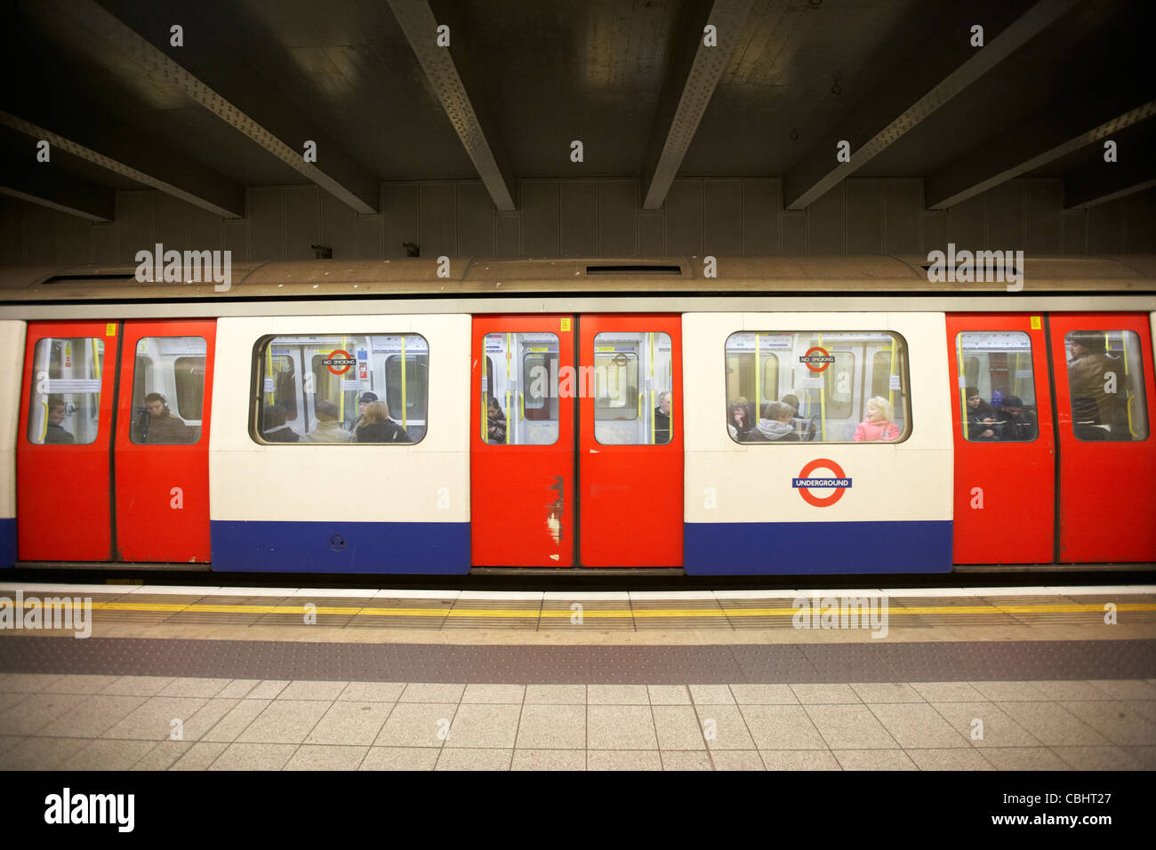 tube train sitting at station london underground england united kingdom uk Stock Photo