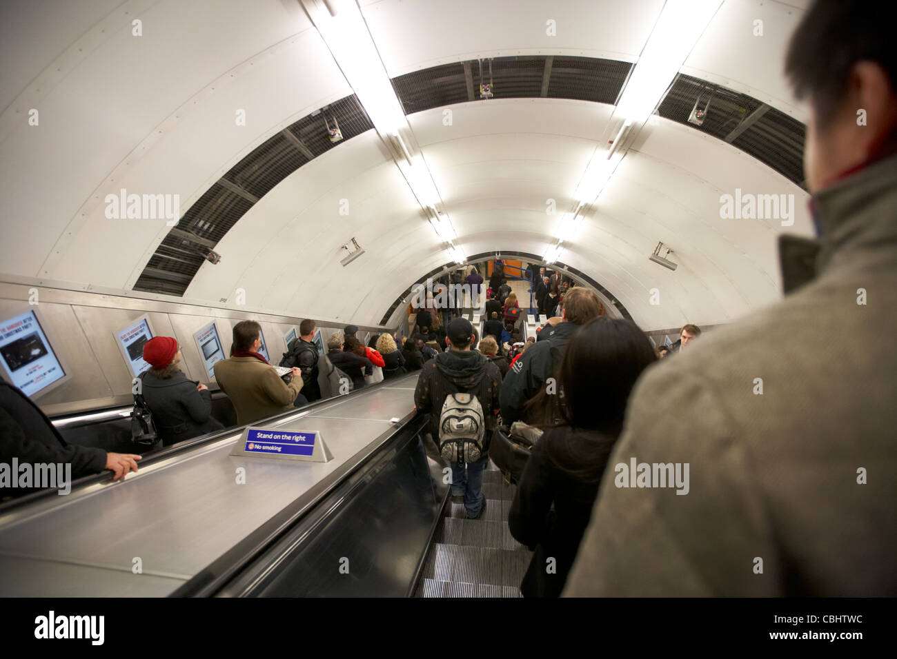 passengers and commuters on the escalator at a london underground tube station england united kingdom uk - Stock Image