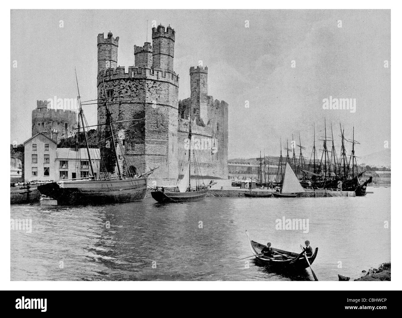 Caernarfon Castle medieval Gwynedd Wales town curtain walls fort fortification bastion tower chateau stronghold - Stock Image