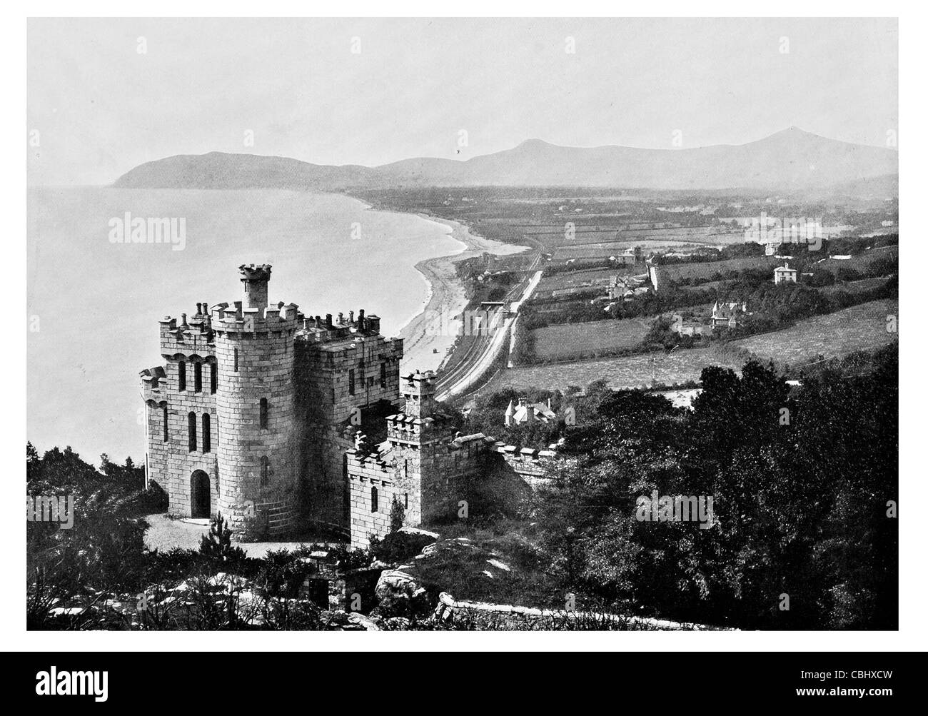 Killiney Castle seaside resort Dublin Ireland beach bay railway track - Stock Image