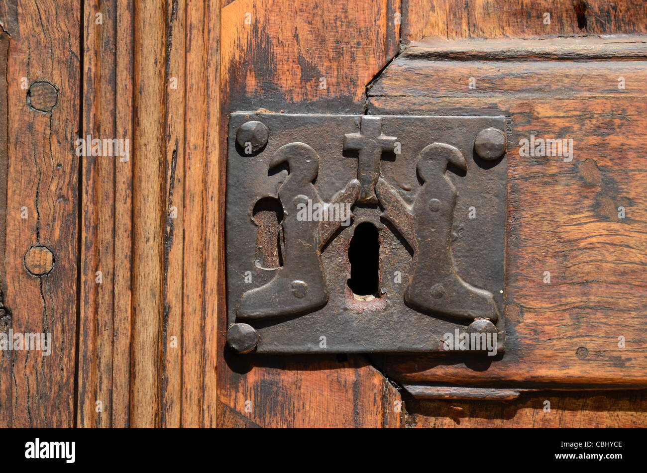 Old Lock with Christian Penitents, Door of Chapel of the White Penitents (1492) La Tour or La Tour-sur-Tinée, - Stock Image