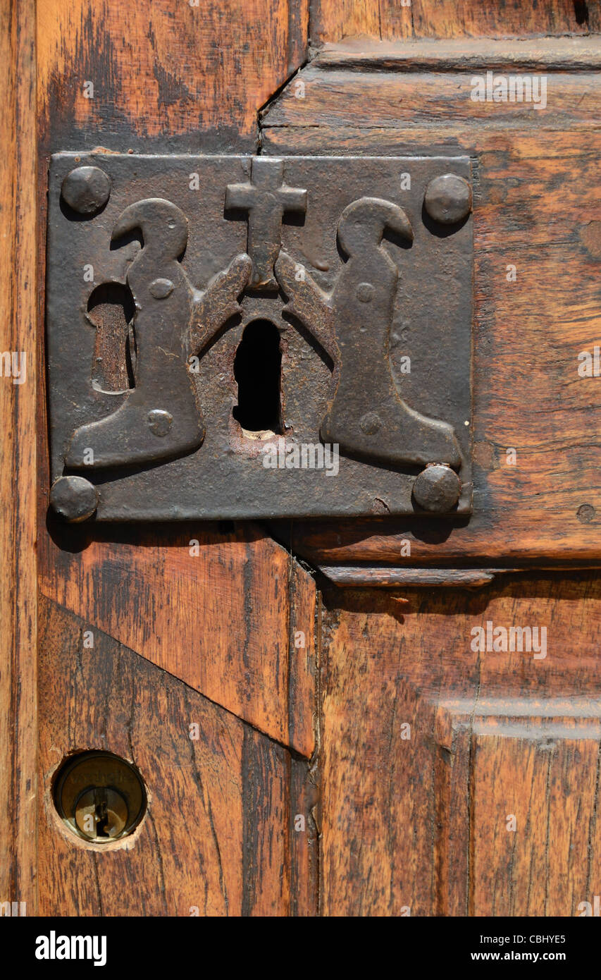 Old Lock with Christian Penitents, Door of Chapel of the White Penitents (1492),  La Tour or La Tour-sur-Tinée, - Stock Image