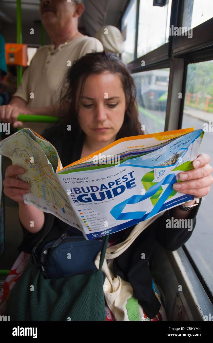 Female tourist reading Budapest Guide information magazine Budapest Hungary Europe - Stock Image