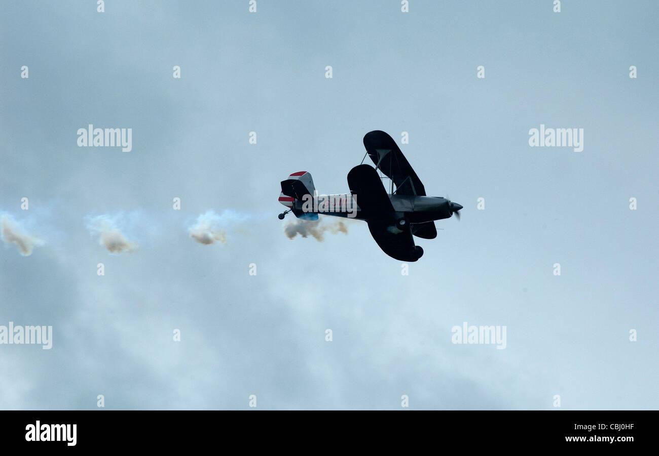 Close-up view of a bi-plane doing areobatics - Stock Image