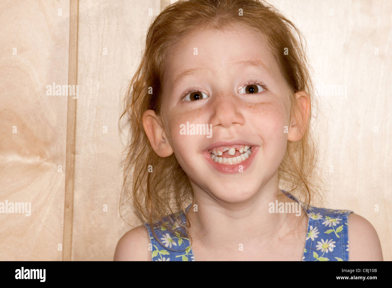 six year old girl funny girl reveals her changing tooth situation. Her deciduous teeth are beginning to fall out - Stock Image