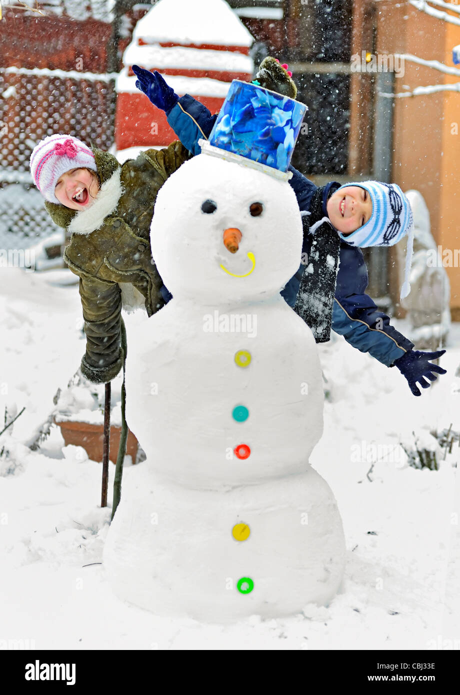 snowman and kids - Stock Image