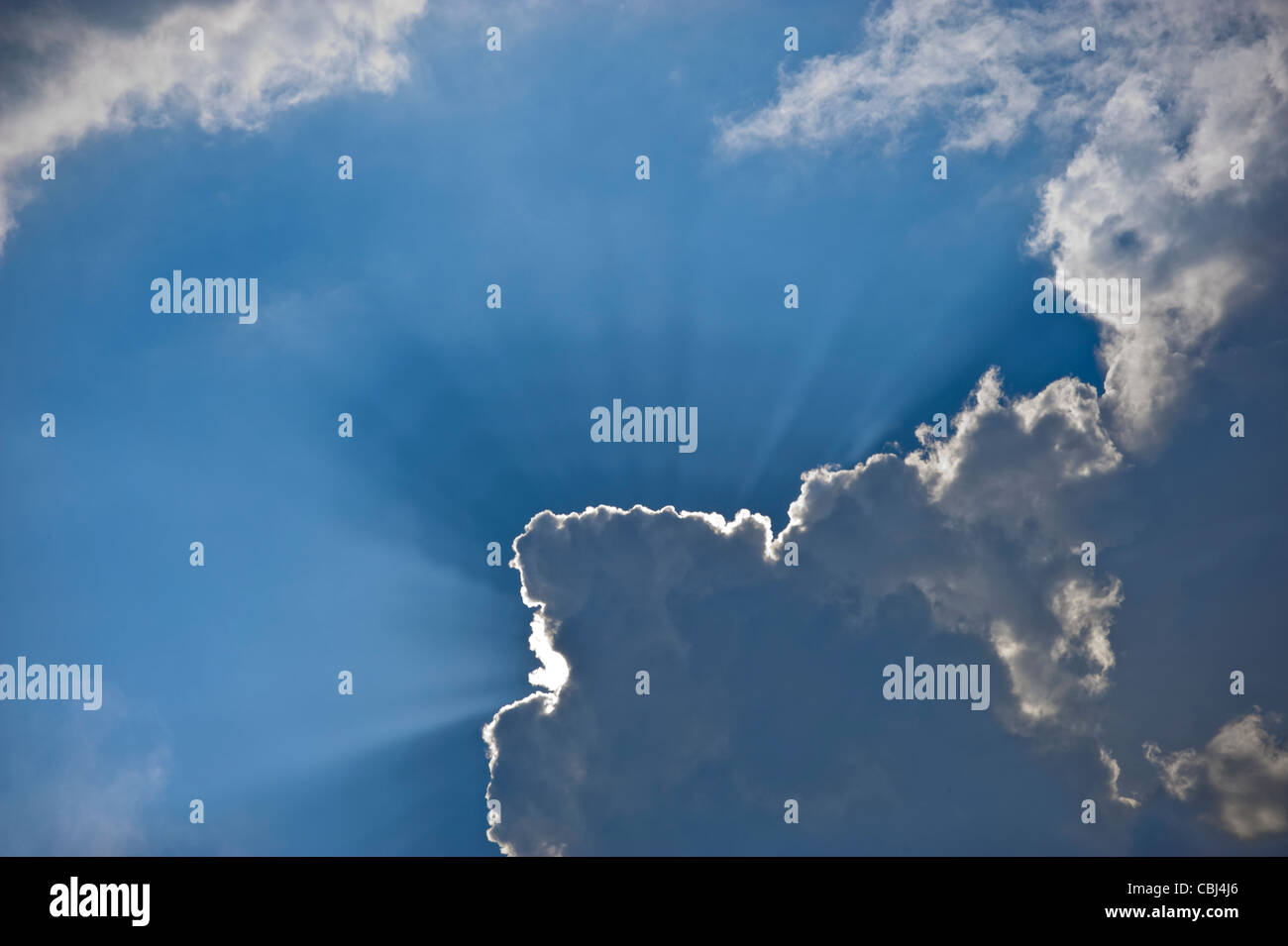 Sun Burst Angel Rays Through Clouds - Stock Image