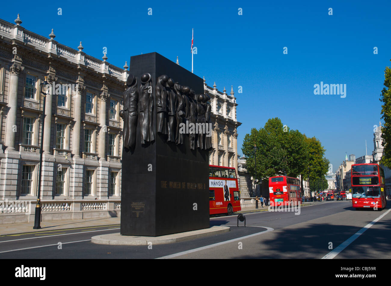 Whitehall street with Women of World War Two memorial Westminster central London England UK Europe - Stock Image