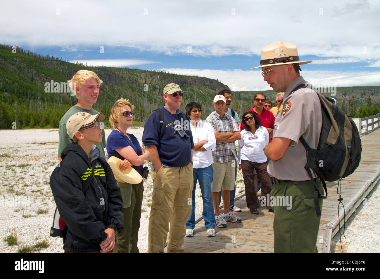 Park ranger giving a tour group information about the Upper Geyser Basin in Yellowstone National Park, Wyoming, - Stock Image